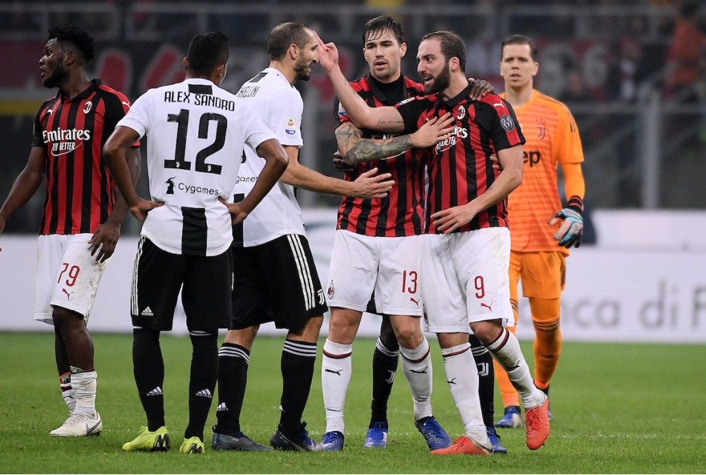 Gonzalo Higuain of AC Milan argues with